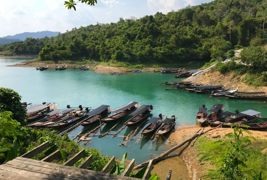 ratchaprapa-dam-thailand-long-tail-boats
